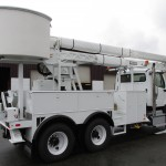 Commercial truck with bucket lift attachment