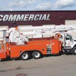 Aerial man lift truck attachment