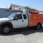 Truck with aerial man lift attachment