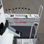 Radial boom derrick controls