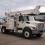 Radial Boom Derrick Truck Attachment