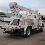 Commercial truck derrick attachment