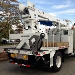 Commercial truck radial boom derrick attachment