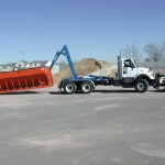 Truck with hooklift equipment carry bin.