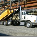 Truck hooklift attachments for bins.