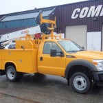 Yellow service truck with hydraulics.