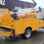 Yellow service truck for construction work.