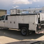 Service truck body with security system.