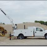 Service truck using service crane.