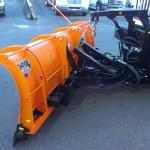 Truck snow shovel attachment