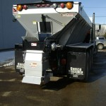 Road salt dispenser truck attachment