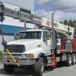 Stiff boom crane attachment for trucks