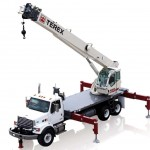 Stiff boom crane attachment on flat bed truck