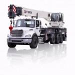 Stiff boom crane attachment on flat bed truck