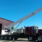 Extended truck boom crane